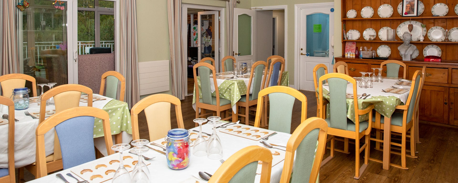 Full view of the care home's dining room ready for lunch