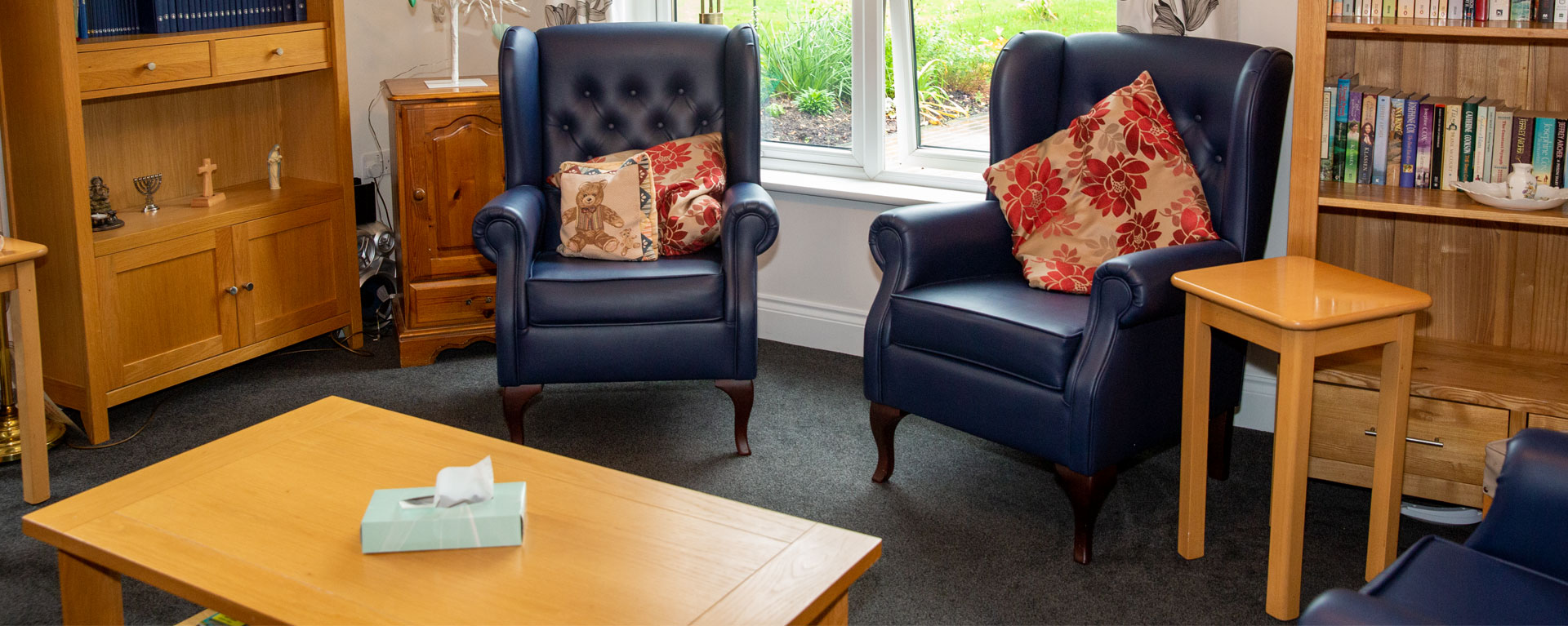 View of the comfy chairs in the care home library