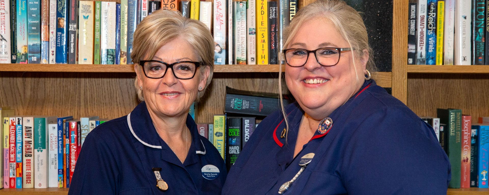 Senior nursing and management staff smiling in the library