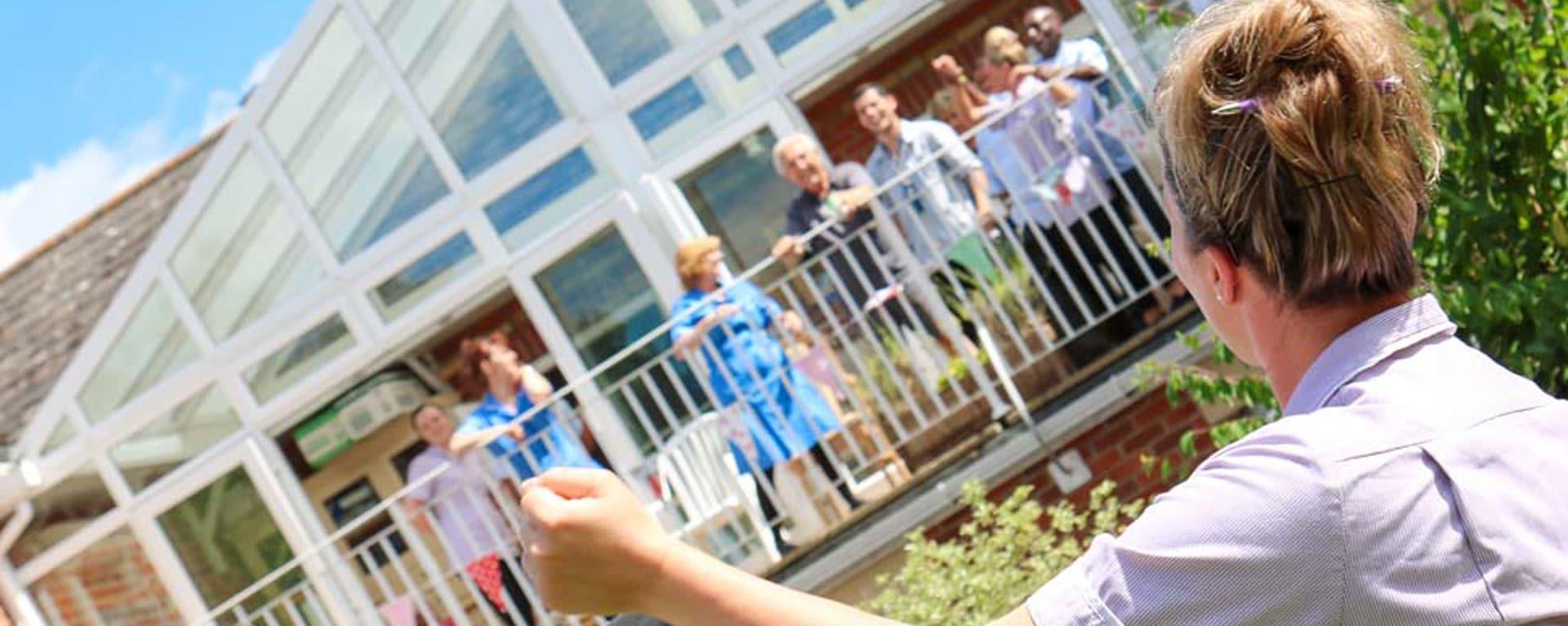 Staff cheering on the balcony