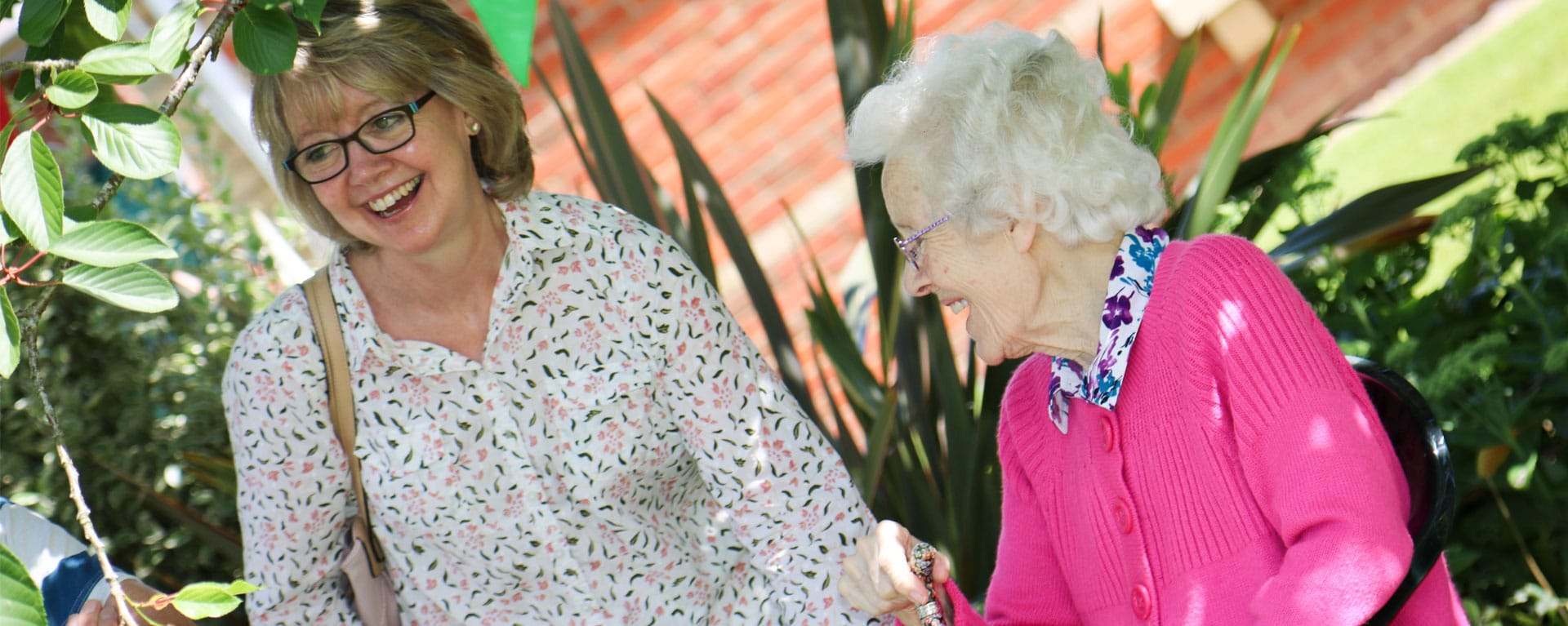 Resident and family member laughing at Laurel Care Home Summer fete