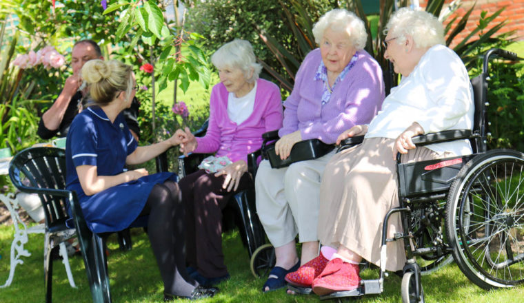 Relatives having a chat in the garden in the summer