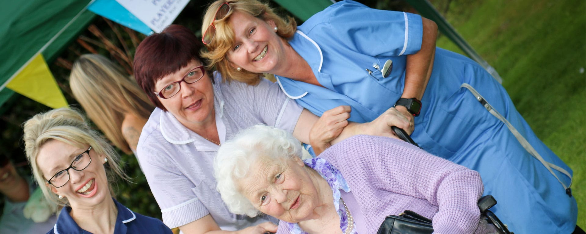 Group of residents and nurses posing for a picture at Laurel Care Home fete