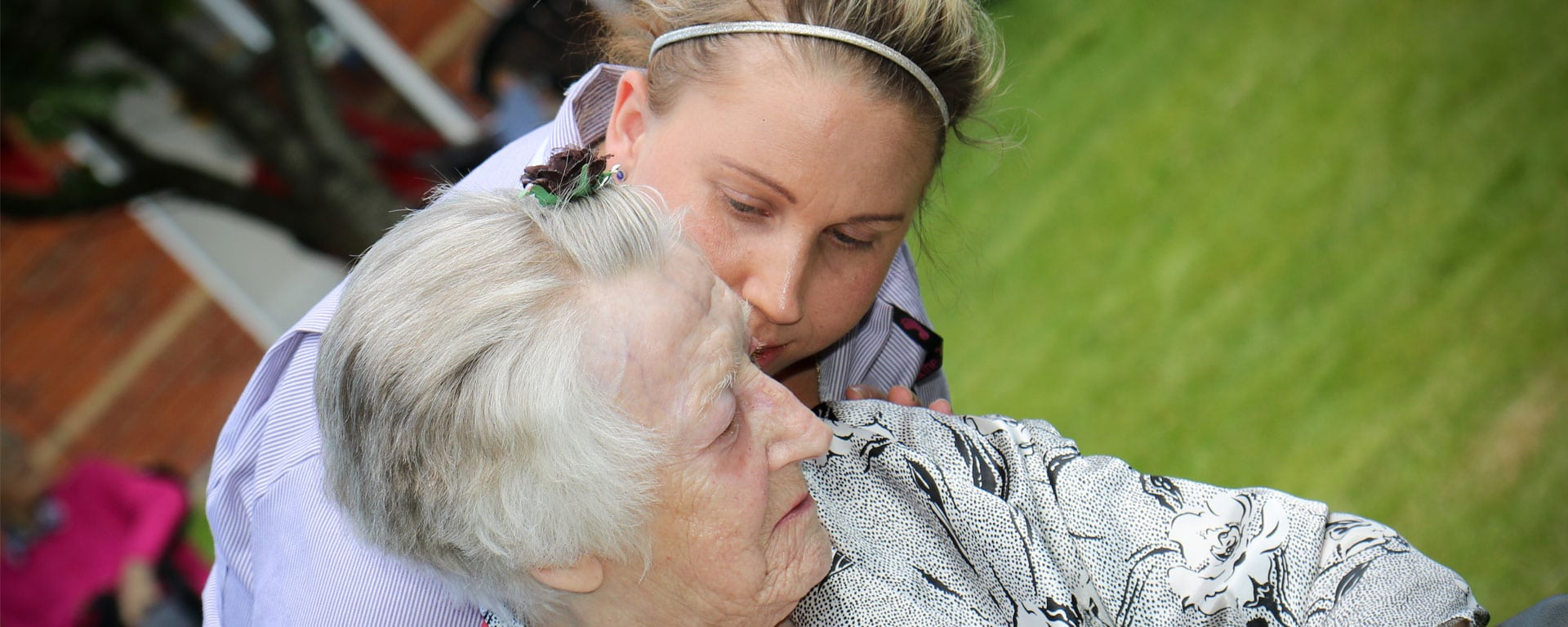 Laurel Care Home Care Assistant Checking on a resident