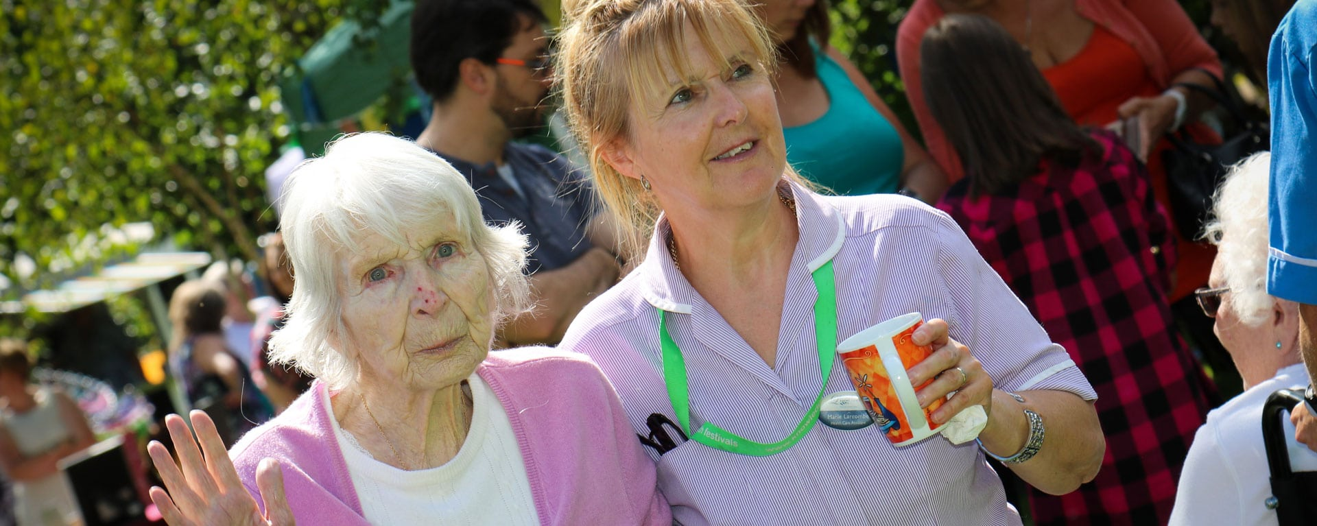 Laurel Care Home nurse with a resident in the garden