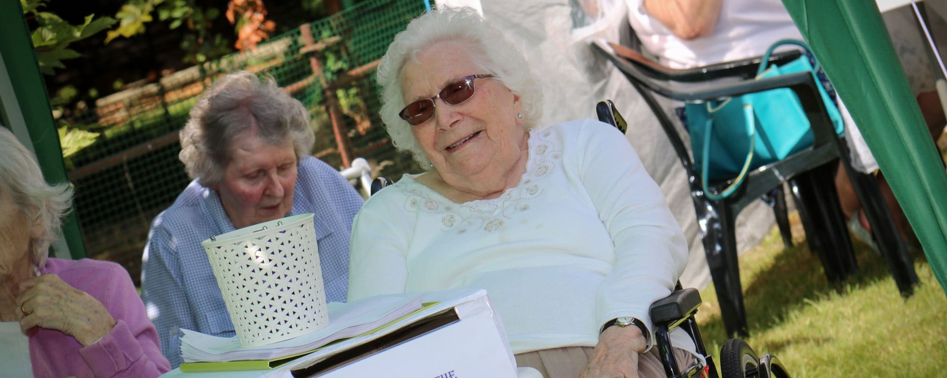 Laurel Care Home resident smiling in the garden