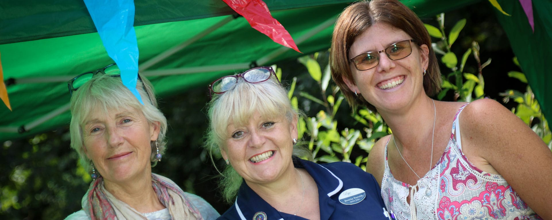 Nurse and residents family members smiling at the fete