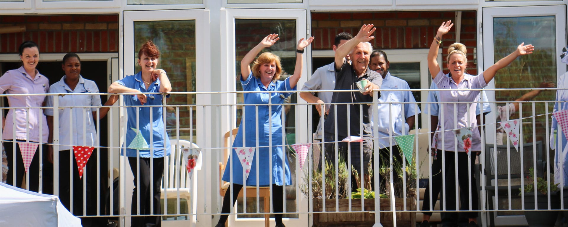 Laurel Care Home staff cheering on the balcony